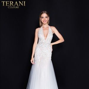 Intricately beaded ivory halter gown